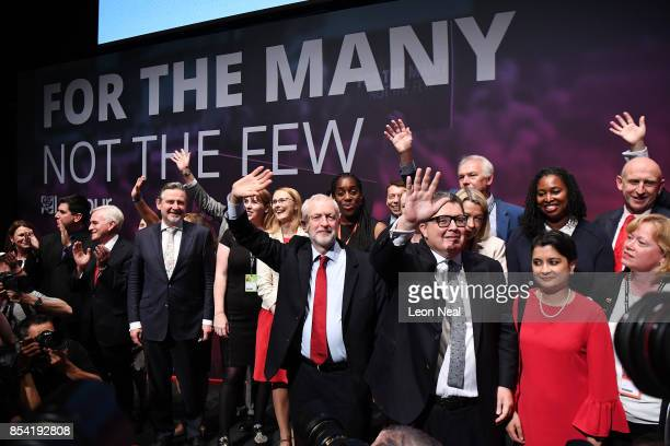 Labour party leader Jeremy Corbyn Deputy Labour party leader Tom Watson and Shadow Attorney General Shami Chakrabarti wave to delegates in the main...