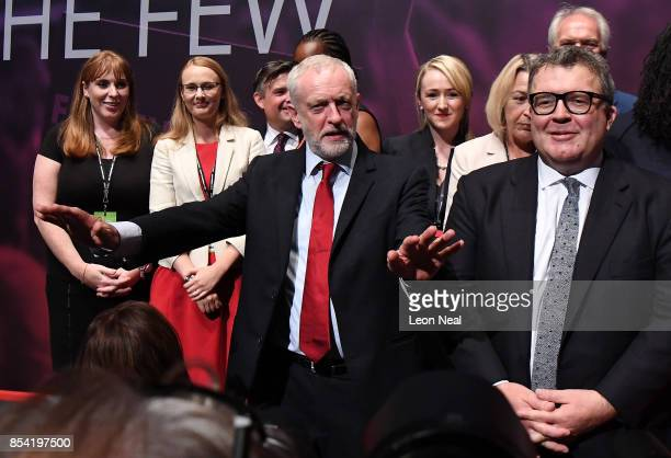 Labour party leader Jeremy Corbyn gestures as Shadow Secretary of State for Education Angela Rayner and Deputy Labour party leader Tom Watson look on...