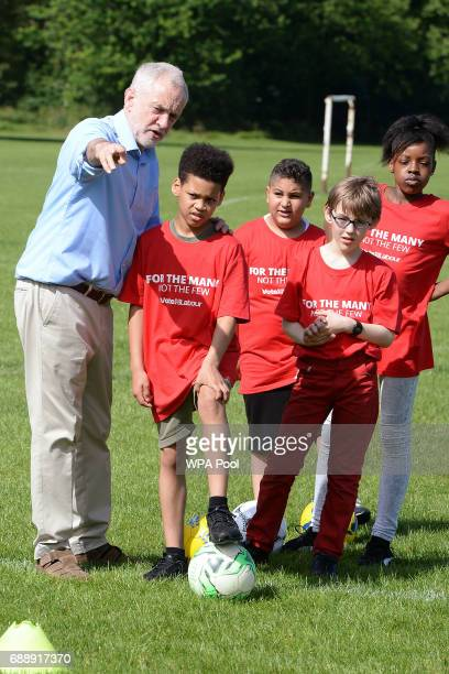 Labour Party leader Jeremy Corbyn gives children advice on football tactics during a visit to Hackney Marshes Football Pitches to highlight Labour's...
