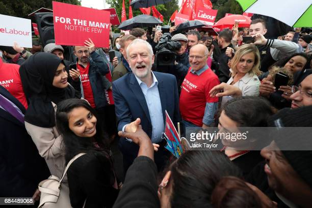 Labour Party leader Jeremy Corbyn greets supporters during a rally on May 18 2017 in Southall England All parties continue to campaign across Britain...