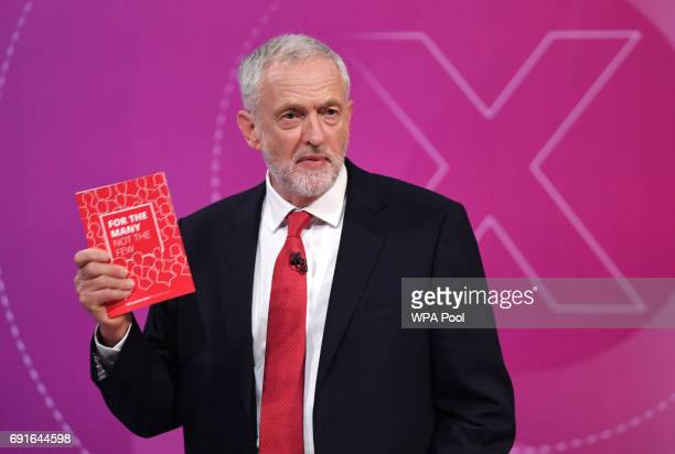 Labour Party Leader Jeremy Corbyn holds up his manifesto as he takes part in the BBC's Question Time programme on June 2 2017 in York England...
