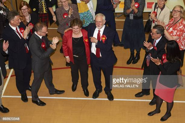 Labour party leader Jeremy Corbyn hugs fellow Labour politician Emily Thornberry as he arrives at the count centre in Islington London early in the...