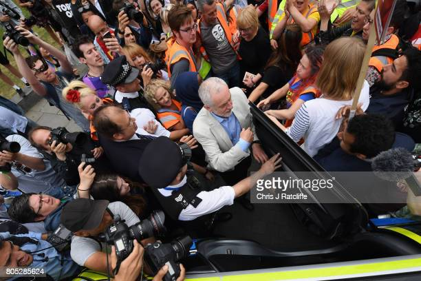 Labour Party leader Jeremy Corbyn is escorted through the crowd by police after speaking to demonstrators during the 'Not One Day More' march at...