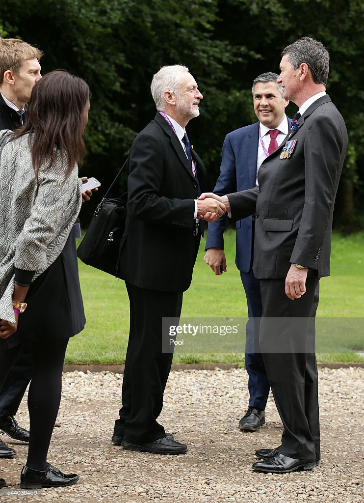 Labour Party leader Jeremy Corbyn (centre) is greeted as he attends the 100th anniversary of the beginning of the Battle of the Somme at the Thiepval memorial to the Missing on July 1, 2016 in Thiepval, France. The event is part of the Commemoration of the Centenary of the Battle of the Somme at the Commonwealth War Graves Commission Thiepval Memorial in Thiepval, France, where 70,000 British and Commonwealth soldiers with no known grave are commemorated.