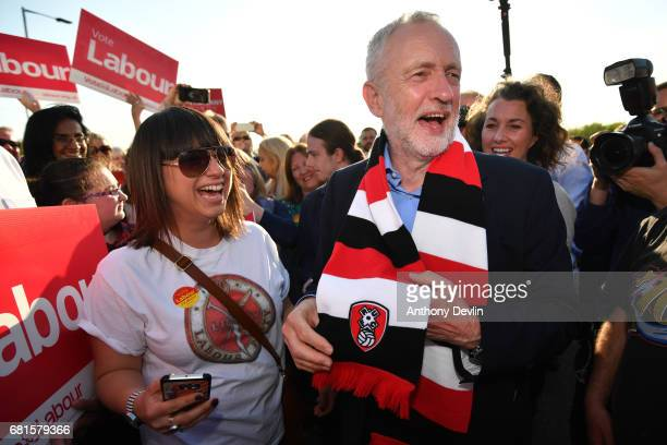 Labour Party leader Jeremy Corbyn is presented a Rotherham United FC scarf by a supporter during a campaign event on May 10 2017 in Rotherham England...