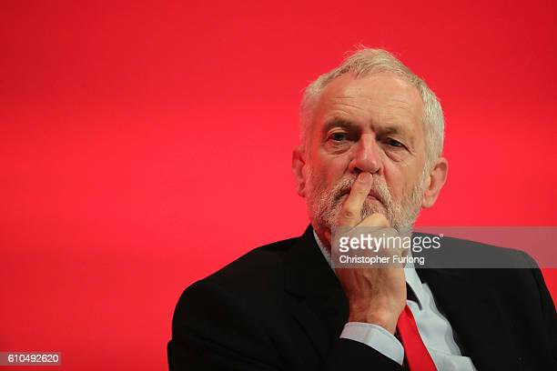 Labour party leader Jeremy Corbyn listens to a speaker during the second day of the Labour party conference on September 26 2016 in Liverpool England...