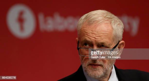 Labour Party leader Jeremy Corbyn listens to speeches during their annual conference at the Brighton Centre Brighton