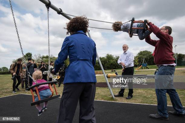 Labour Party leader Jeremy Corbyn looks on as local parliamentary candidate Anneliese Dodds and her husband Ed push their children Isabella and...