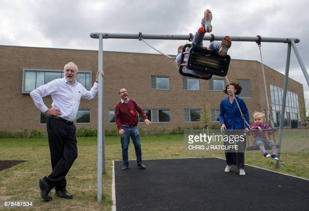 Labour Party leader Jeremy Corbyn looks on as Oxford East candidate Anneliese Dodds pushes her children Isabella and Freddie as her husband Ed looks...