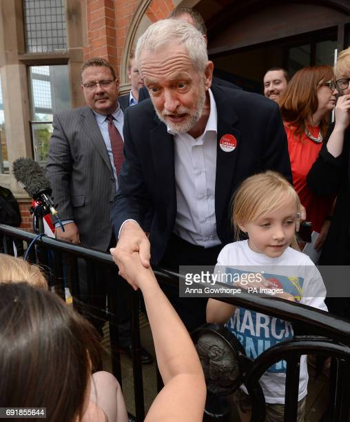 Labour Party leader Jeremy Corbyn meets children during a rally in Hucknall Market Place during a General Election campaigning