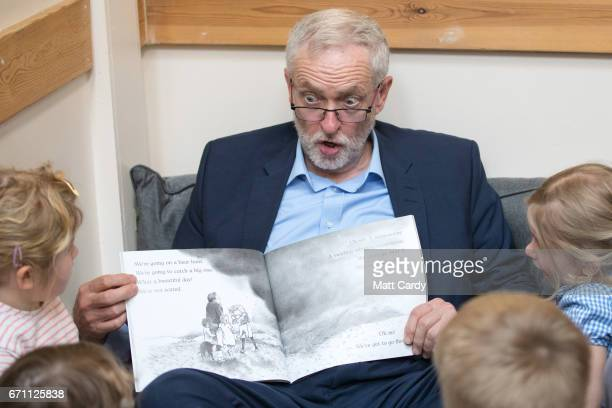 Labour party leader Jeremy Corbyn reads the book 'We're Going on a Bear Hunt' to children at a visit to Brentry Children's Centre on April 21 2017 in...