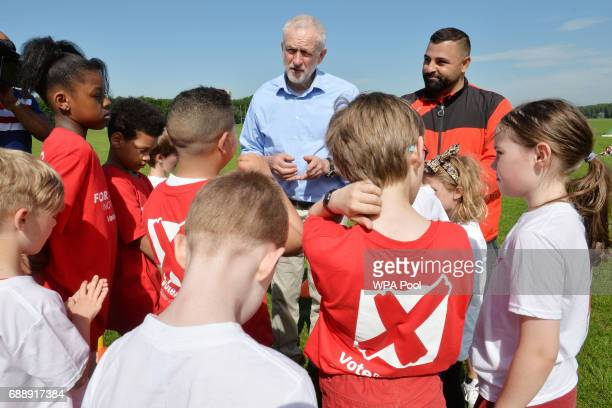 Labour Party leader Jeremy Corbyn speaks to children during a visit to Hackney Marshes Football Pitches to highlight Labour's manifesto commitment to...