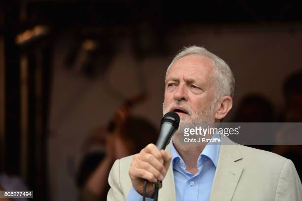 Labour Party leader Jeremy Corbyn speaks to demonstrators during the 'Not One Day More' march at Parliament Square on July 1 2017 in London England...