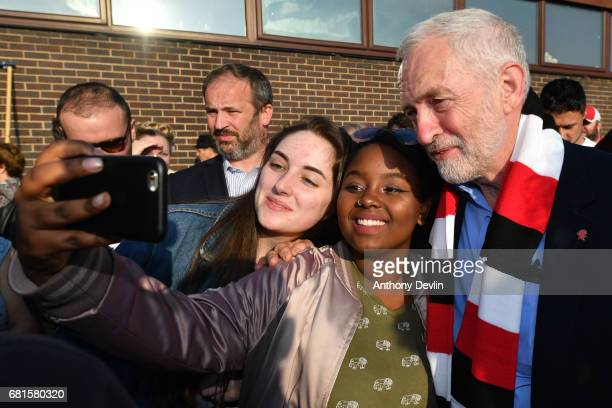 Labour Party leader Jeremy Corbyn takes selfie photo with supporters after being presented a Rotherham United FC scarf during a campaign event on May...