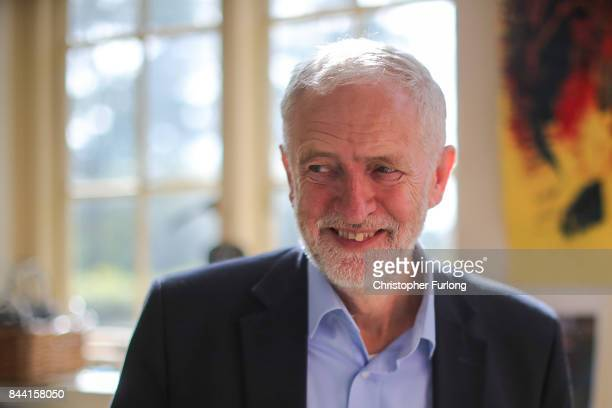 Labour Party Leader Jeremy Corbyn talks to children and staff during a visit to the Pen Green Centre on September 8 2017 in Corby England The Pen...