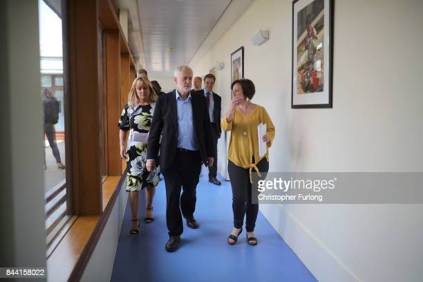 Labour Party Leader Jeremy Corbyn talks to staff during a visit to the Pen Green Centre on September 8 2017 in Corby England The Pen Green Centre is...