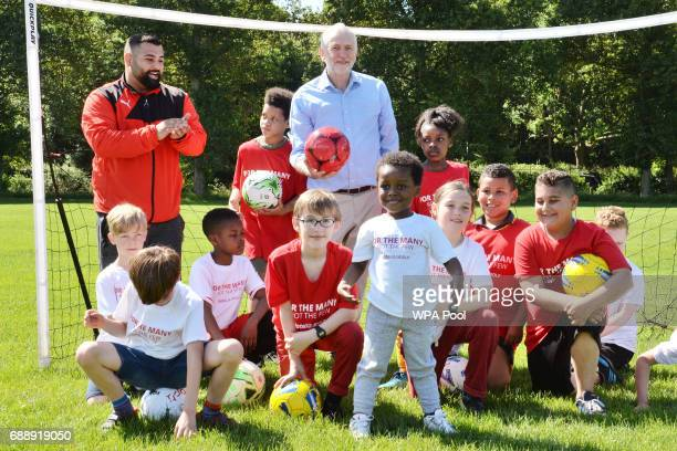 Labour Party leader Jeremy Corbyn with children during a visit to Hackney Marshes Football Pitches to highlight Labour's manifesto commitment to...