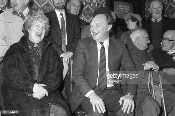 Labour Party leader Neil Kinnock chats to EastEnders actress Anna Wing in the Jubilee Room of the House of Commons They joined a delegation of London...