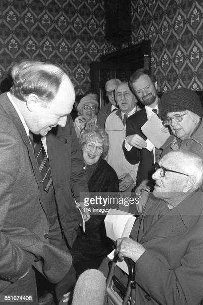 Labour Party leader Neil Kinnock meets 100yearold Arthur Woollett of the Putney and Roehampton Old People's Organisation in the Jubilee Room of the...