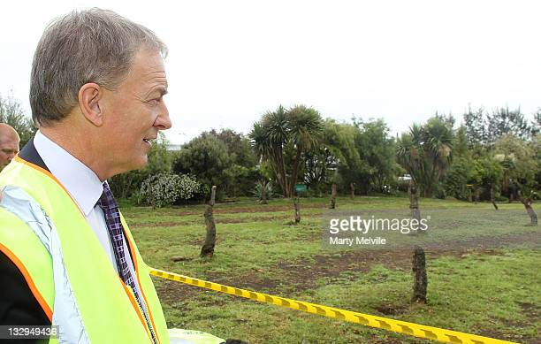 Labour Party leader Phil Goff looks at a section of Gold Kiwifruit vines that were cut out due to PSA disease at the Trevelyan Kiwi Fruit Orchard on...