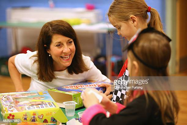 Labour party leadership candidate Liz Kendall joins children in a craft workshop during a visit to the Kidszone children's centre in Withington on...