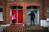 Labour Party Member of Parliament Stephen Twigg knocks on a door as he helps party workers canvass for votes in Battersea on January 31 2015 in south...