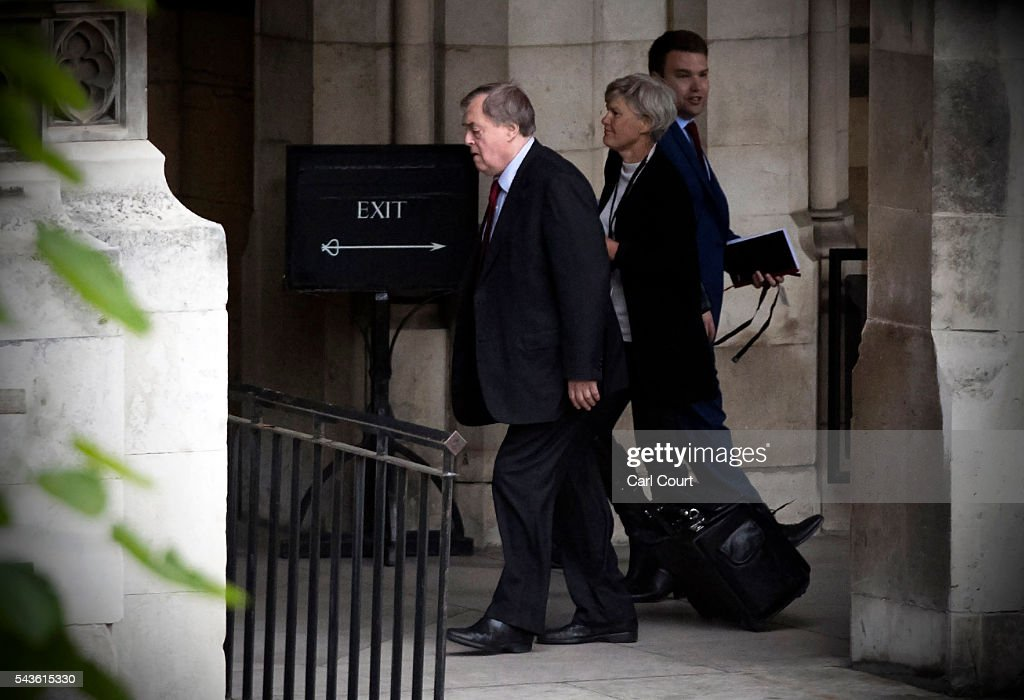 Labour Party peer John Prescott (L) walks through the Houses of Parliament on June 29, 2016 in London, England. Labour Party leader Jeremy Corbyn faced continued calls to step down today as former party leader Ed Miliband and Prime Minister David Cameron both urged him to resign.