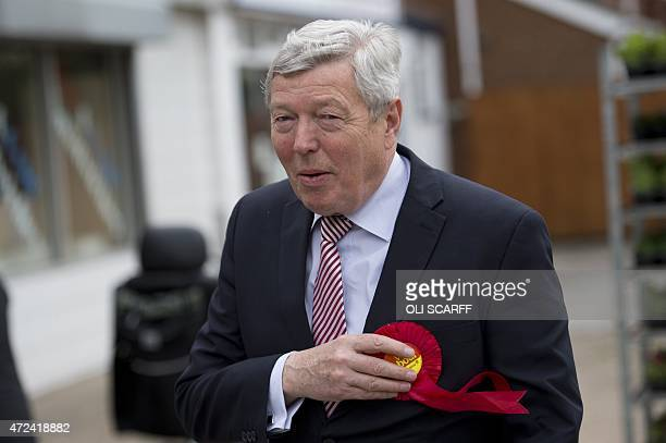 Labour Party politician Alan Johnson arrives at the Ush Hair hairdressing salon which is being used as a polling station in Hull Northern England on...