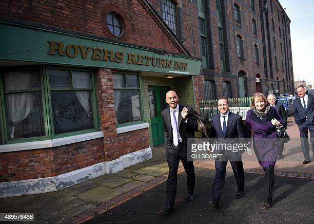 Labour Party politicians and candidates Chuka Umunna and Harriet Harman walk with colleagues past the Rovers Return pub from the television series...