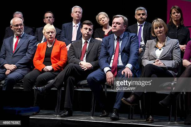 Labour Party politicians and members of the shadow cabinet including Ed Balls and Harriet Harman listen as Ed Miliband leader of the opposition...