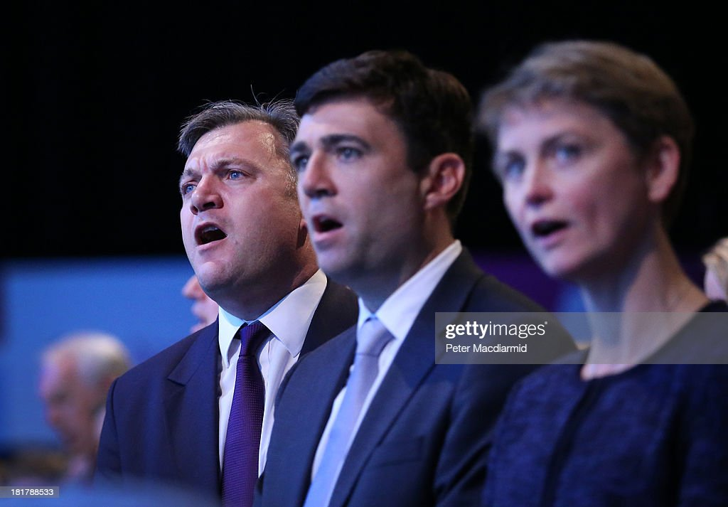 Labour party shadow cabinet members (L-R) <a gi-track='captionPersonalityLinkClicked' href=/galleries/search?phrase=Ed+Balls&family=editorial&specificpeople=3244683 ng-click='$event.stopPropagation()'>Ed Balls</a>, Andy burnham and <a gi-track='captionPersonalityLinkClicked' href=/galleries/search?phrase=Yvette+Cooper&family=editorial&specificpeople=2486558 ng-click='$event.stopPropagation()'>Yvette Cooper</a> sing the traditional Red Flag song at the Labour Party conference on September 25, 2013 in Brighton, England. Party leader Ed Miliband finished the four day conference with a question and answer session.