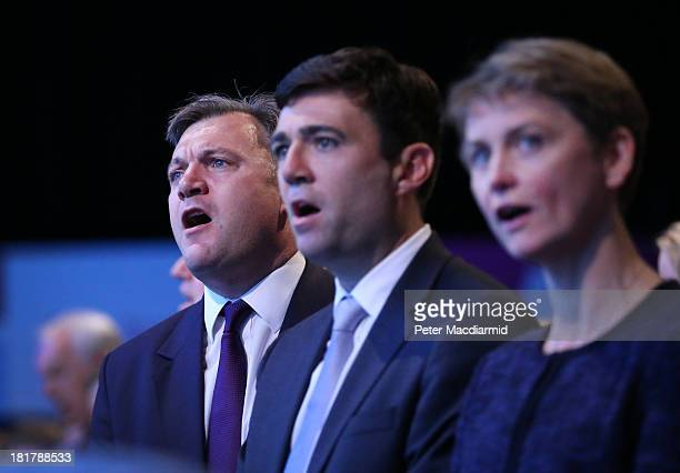 Labour party shadow cabinet members Ed Balls Andy burnham and Yvette Cooper sing the traditional Red Flag song at the Labour Party conference on...