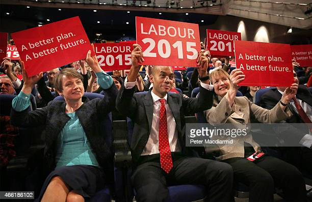 Labour party shadow cabinet members Yvette Cooper Chuka Umunna and Harriet Harman wave placards during a rally The ICC on March 14 2015 in Birmingham...