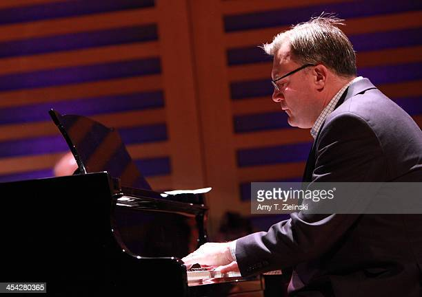 Labour Party Shadow Chancellor Ed Balls plays on the piano a movement from composer Robert Schumann's Kinderszenen during rehearsal on stage before...