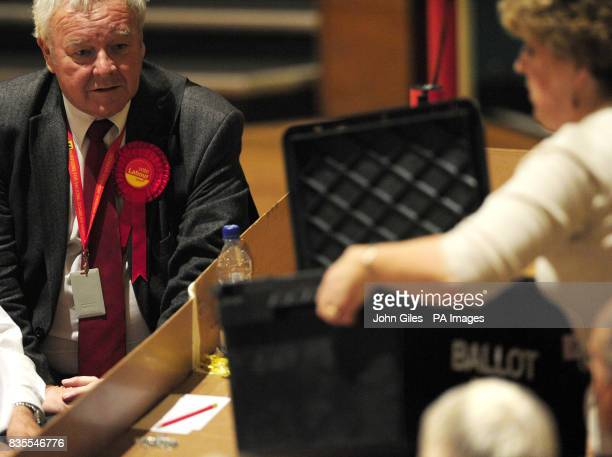 A Labour Party supporter watches as ballot papers for the Local and European Parliament elections are sorted and counted in Preston