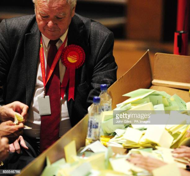 A Labour Party supporter watches as ballot papers for the Local and European Parliament elections are sorted in Preston