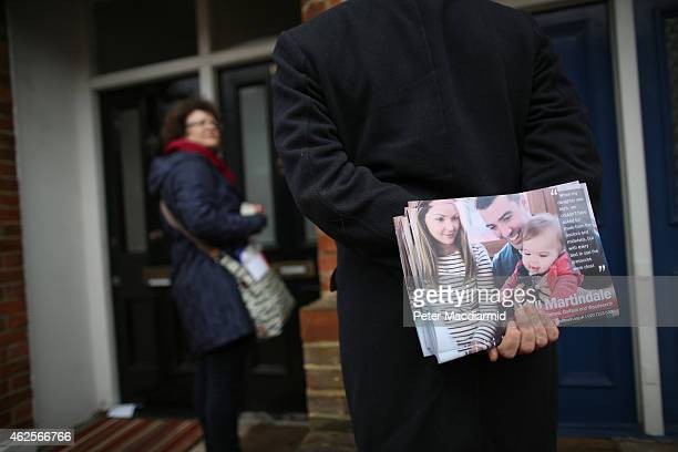 Labour Party worker holds leaflets for distribution as he canvasses for votes in Battersea on January 31 2015 in south London England Campaigning for...