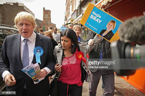 Labour prospective parliamentary candidate for Ealing Central and Acton constituency Rupa Huq is grabbed from behind by Karim Sacoor a campaign...