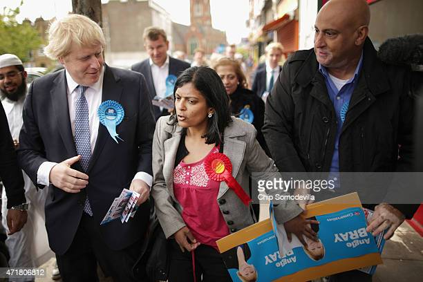 Labour prospective parliamentary candidate for Ealing Central and Acton constituency Rupa Huq tries to debate with London Mayor Boris Johnson as he...