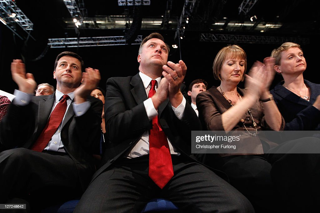 Labour shadow cabinet members (L-R) <a gi-track='captionPersonalityLinkClicked' href=/galleries/search?phrase=Douglas+Alexander&family=editorial&specificpeople=616758 ng-click='$event.stopPropagation()'>Douglas Alexander</a>, <a gi-track='captionPersonalityLinkClicked' href=/galleries/search?phrase=Ed+Balls&family=editorial&specificpeople=3244683 ng-click='$event.stopPropagation()'>Ed Balls</a>, <a gi-track='captionPersonalityLinkClicked' href=/galleries/search?phrase=Harriet+Harman&family=editorial&specificpeople=839866 ng-click='$event.stopPropagation()'>Harriet Harman</a> and <a gi-track='captionPersonalityLinkClicked' href=/galleries/search?phrase=Yvette+Cooper&family=editorial&specificpeople=2486558 ng-click='$event.stopPropagation()'>Yvette Cooper</a> listen to party leader Ed Miliband deliver his keynote speech to members and delegates during the annual Labour party conference at the Echo Arena on September 27, 2011 in Liverpool, England. It was Ed Miliband's most important speech since becoming Labour leader a year ago and focussed on Britain's 'fast buck' culture, set out his belief that hard workers should be rewarded, and also said 'Labour will always stand as the voice of the people, our people'.