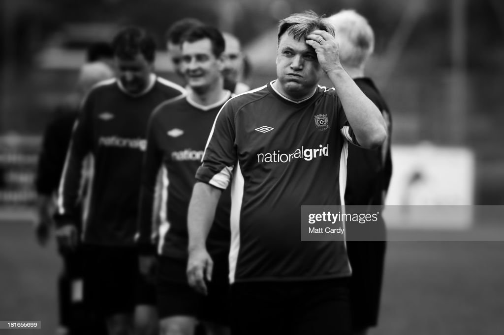 Labour shadow chancellor <a gi-track='captionPersonalityLinkClicked' href=/galleries/search?phrase=Ed+Balls&family=editorial&specificpeople=3244683 ng-click='$event.stopPropagation()'>Ed Balls</a> plays football in a match against the Lobby XI, a team made up of journalists at the Sussex County FA ground as part of the Labour Party conference on September 22, 2013 in Brighton, England. The opposition Labour Party are holding their annual conference in the southern English coastal town for the next four days.