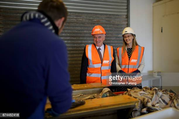 Labour Shadow Chancellor John McDonnell and Cat Smith talk to workers during an election campaign visit to Fleetwood Fishing Port on April 28 2017 in...