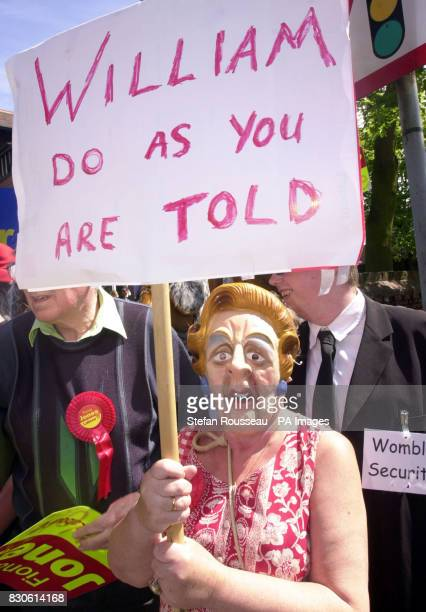 A Labour supporter makes his presence known at The Conservative Club in Newark where Tory leader William Hague met Conservative Party members *...