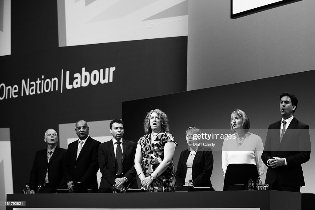 Labour supporters including Party leader Ed Miliband (far right) and deputy leader Harriet Harman (2nd right) sing the Red Flag at the end of the Labour Party conference on September 25, 2013 in Brighton, England. Today was the last day of opposition Labour Party's annual conference in the southern English coastal town.