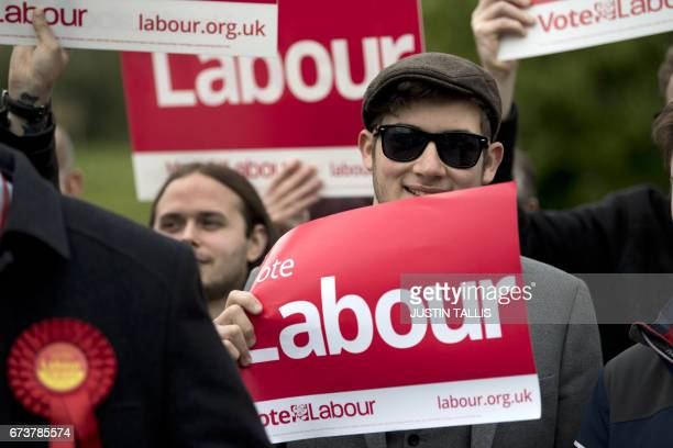 Labour supporters wait for the arrival of Britain's opposition Labour Party Leader Jeremy Corbyn for a campaign meeting in Harlow Town Park Essex...