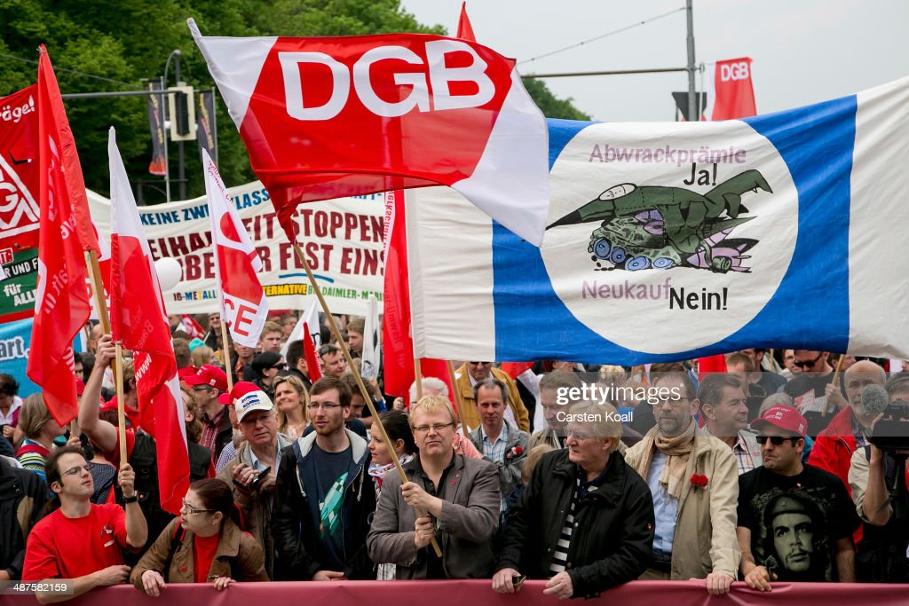 Labour union members congregate in front of the Brandenburg Gate after marching through the city center on May 1, 2014 in Berlin, Germany. May Day, the international day of labour, is a national holiday in Germany and observed with gatherings by labour unions and political parties. In some cities, including Hamburg and Berlin, the day often ends with violent clashes between police and mostly left-wing demonstrators.
