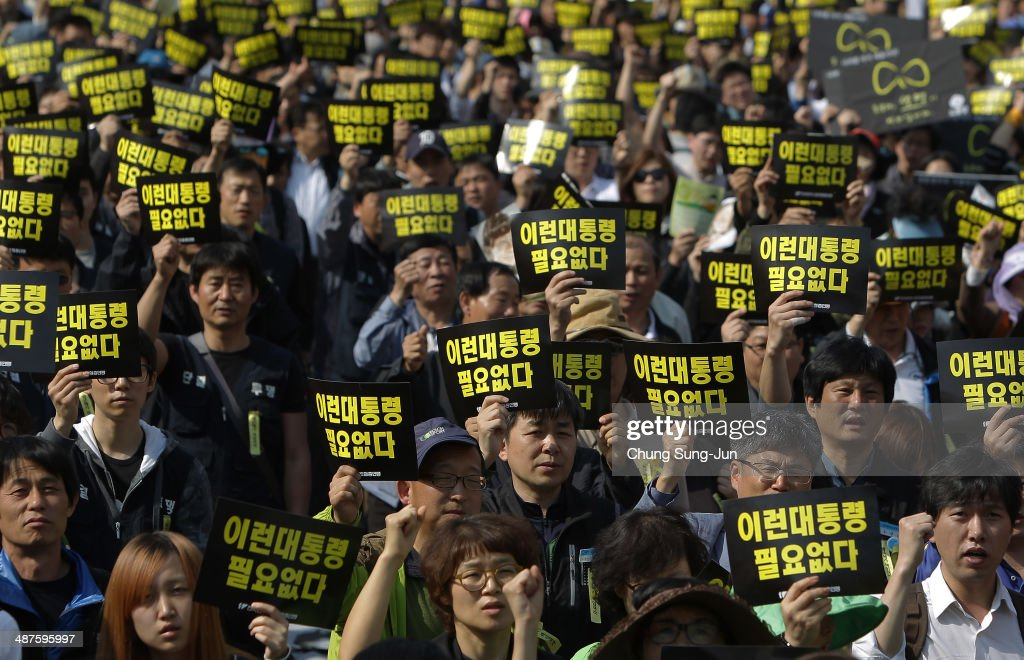 Labour union members hold up placards reading 'We don't need this kind of president' during a May Day rally organized by the Korean Confederation of Trade Unions (KCTU) at the Seoul Railway Station on May 1, 2014 in Seoul, South Korea. South Korea's another biggest trade union, the Federation of Korean Trade Unions (FKTU) had announced cancellation of its annual May Day rally to mourn the ferry disaster victims.