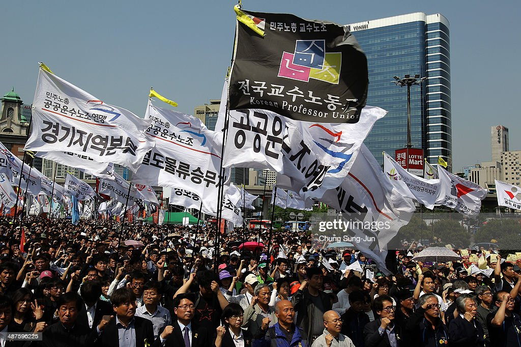 Labour union members participate in a May Day rally organized by the Korean Confederation of Trade Unions (KCTU) at the Seoul Railway Station on May 1, 2014 in Seoul, South Korea. South Korea's another biggest trade union, the Federation of Korean Trade Unions (FKTU) had announced cancellation of its annual May Day rally to mourn the ferry disaster victims.