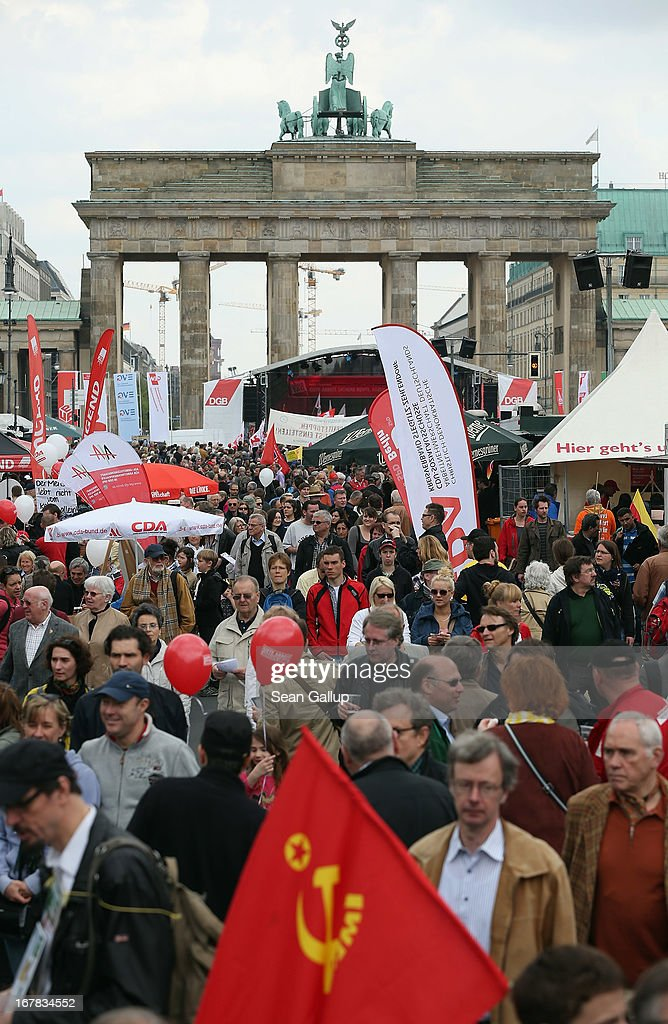 Labour union representatives and other groups congregate in front of the Brandenburg Gate after amrching through the city center on May Day on May 1, 2013 in Berlin, Germany. May Day, the international day of labour, is a national holiday in Germany and observed with gatherings by labour unions and political parties. In some cities, including Hamburg and Berlin, the day often ends with violent clashes between police and mostly left-wing demonstrators.