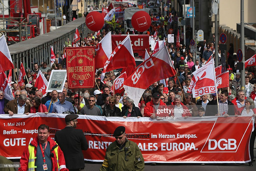 Labour union representatives and other groups march in support of fairer employment conditions, a minimum wage and other labour-related causes on May Day on May 1, 2013 in Berlin, Germany. May Day, the international day of labour, is a national holiday in Germany and observed with gatherings by labour unions and political parties. In some cities, including Hamburg and Berlin, the day often ends with violent clashes between police and mostly left-wing demonstrators.